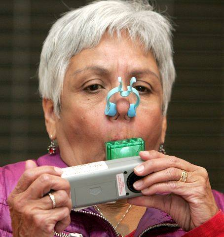 Marge Merchut of Carol Stream performs a pulmonary function test to measure her lung capacity during Adventist GlenOaks Hospital's Walk the Mall for Life program held Saturday inside Stratford Square Mall in Bloomingdale.