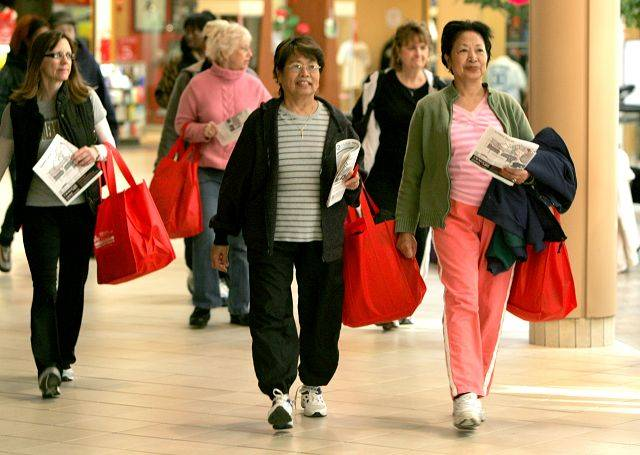 Catalina Maranion, center, and her sister Antonia Calimlim, both of Glendale Heights, walk with goody bags full of health information they gathered during Adventist GlenOaks Hospital's Walk the Mall for Life event Saturday inside Stratford Square Mall in Bloomingdale.