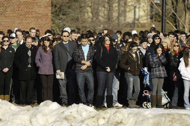 Students line the sidewalks at Northern Illinois University during a memorial service for those killed three years ago Monday.