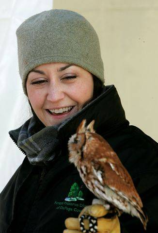 Stephanie Touzalin, of the DuPage County Forest Preserve, displays an eastern screech owl during the Wonders of Winter event held at the the Mayslake Forest Preserve in Oak Brook.