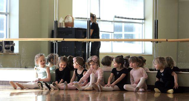 Girls wait for instruction during Dixon Dance Academy Creative Dance 1 and 2 at the Centre in Elgin Tuesday, February 8.