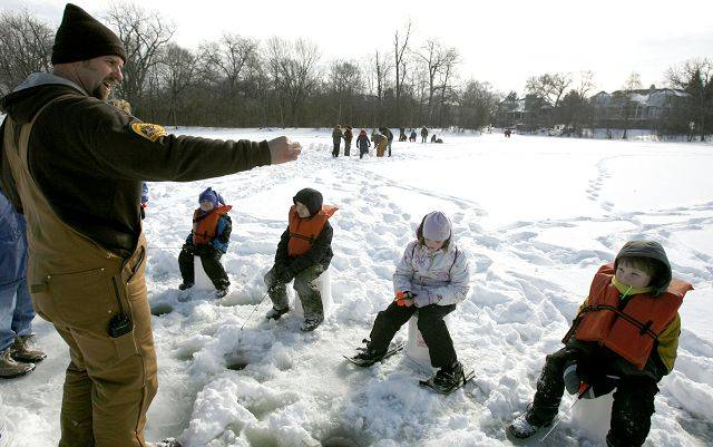 Marty Jandura, DuPage County Forest Preserve Ranger, teaches ice fishing during the Wonders of Winter event held at the the Mayslake Forest Preserve in Oak Brook.