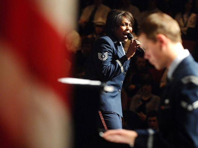 Technical Sergeant Keisha Gwin-Goodin performs a vocal solo while Airman First Class Mike Mitchell plays piano during a concert by the United States Air Force Shades of Blue Jazz Ensemble at Geneva High School Thursday evening.