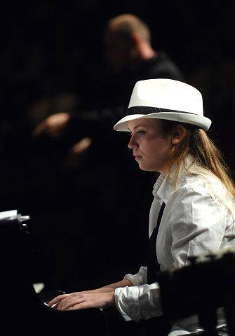 Alyssa Hensley of GHS Jazz Band II plays piano while Shawn Maxwell conducts behind her as they play before a concert by the United States Air Force Shades of Blue Jazz Ensemble at Geneva High School Thursday evening.