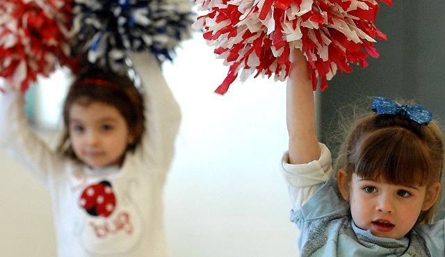 Brooke Hall, 4, of St. Charles, right, and Danielle Gregory, 4, of Geneva perform for their parents during the last session of the All Star Pommers Dance Team Express class at the Pottawatomie Community Center in St. Charles Tuesday. The 5 week class will begin anew on Feb. 22.
