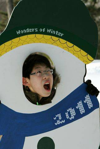 Joshua Tak, 10, of Lisle humors his relatives during the Wonders of Winter event.