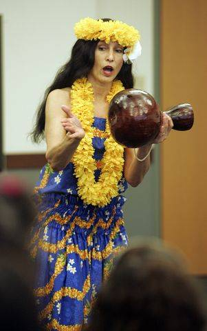 Tiare Rano, of Mt. Prospect, performs as the North Aurora Messenger Library presents Escape the Snow and Cold with the Aloha Dancers Saturday.
