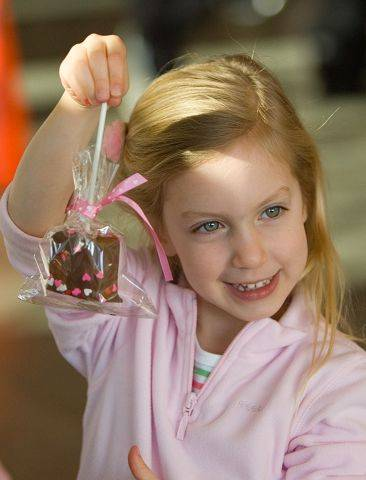 Madelene Schultz, 4, of St. Charles is ready to enjoy her treat from Traviata Chocolate & Gelato in Lisle, during the second-annual Chocolate Expo held at the Morton Arboretum in Lisle.