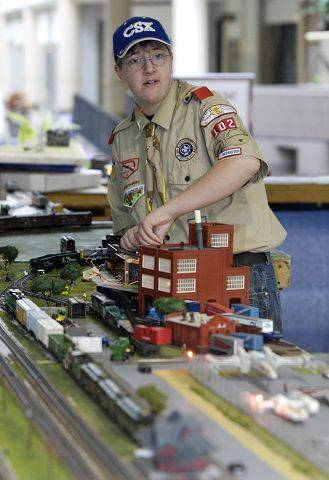 Marcus Mitzel, 15 of Mendota and Boy Scout Troop 102, sets up his trains for the last day of the Rail-Rama 2011 train show at Charlestowne Mall in St. Charles. The show was presented by the Boy Scouts Venture Crew 9911.