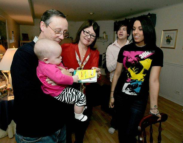 Five-month-old Savannah Grace Dubowski is the center of attention during a recent visit with parents Ryan and Brittany to her grandparents Joe and Laurel Dubowski's Carol Stream house.