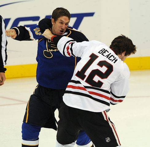 The Blues' B.J. Crombeen, left, and the Blackhawks' Kyle Beach fight during a preseason game last September.