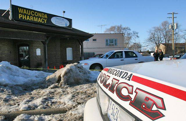 Wauconda police investigate a shooting in what police are calling an armed robbery attempt at the Wauconda Pharmacy on Monday afternoon.