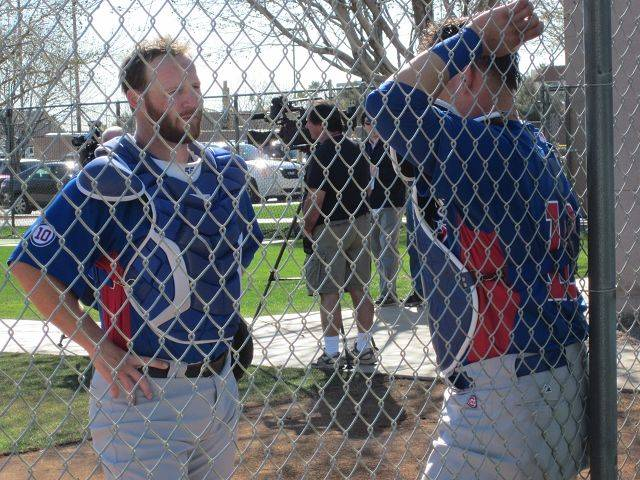 Cubs catchers Koyie Hill, left and Geovany Soto had a few things to discuss Tuesday during the second day of workouts in Mesa, Ariz.