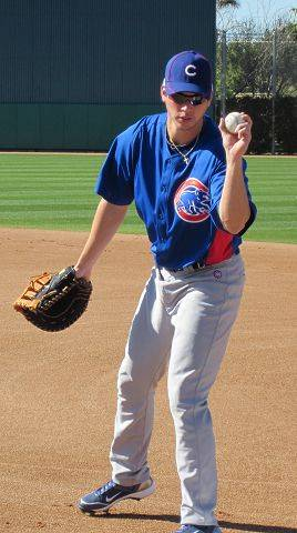 Cubs outfielder Tyler Colvin warms up Tuesday with some infield drills during workouts in Mesa, Ariz.