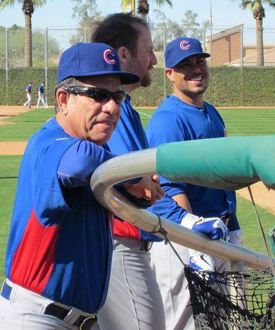 Cubs hitting coach Rudy Jaramillo checks out the activity around the batting cage during workouts Tuesday at Cubs camp in Mesa, Ariz.