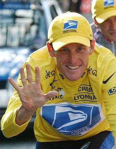 Lance Armstrong signals five after winning his fifth consecutive Tour de France cycling race in 2003.