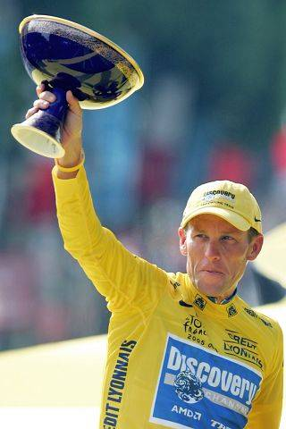 Lance Armstrong holds the winner's trophy in 2005 after winning his seventh straight Tour de France cycling race, during ceremonies on the Champs-Elysees avenue in Paris.