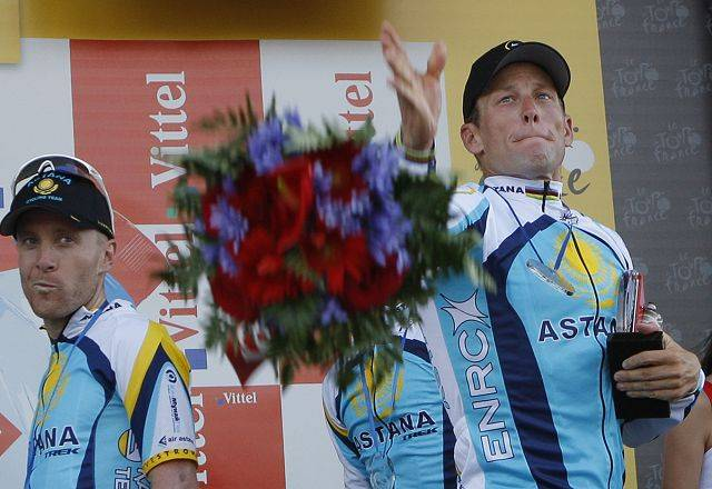 Lance Armstrong, right, and American Levi Leipheimer, left, react on the podium after winning the fourth stage of the Tour de France cycling race, a team time-trial over 39 kilometers (24.2 miles) with start and finish in Montpellier, southern France in 2009.