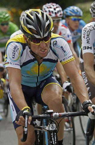 Lance Armstrong strains as he rides in the pack during 11th stage of the Tour de France cycling race in 2009.