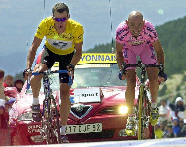 Marco Pantani, right, of Italy, sprints to beat overall leader Lance Armstrong, of Austin, Texas, and capture the 12th stage of the Tour de France cycling race between Carpentras and Mont Ventoux, southern France, Thursday, July 13, 2000.