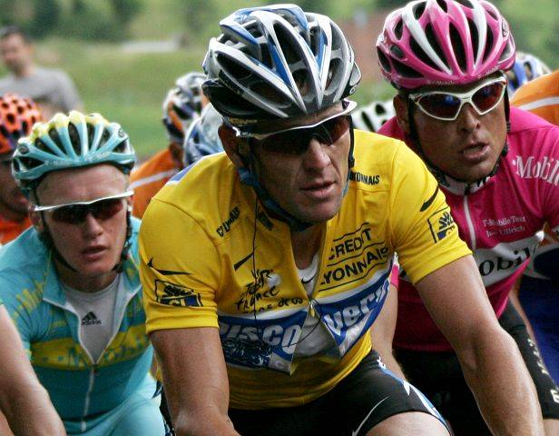 Overall leader, six-time Tour de France winner and leader of the Discovery Channel cycling team, Lance Armstrong of Austin, Texas, foreground, Jan Ullrich of Germany, right, and Alexandre Vinokourov of Kazakhstan ride up the Schlucht pass near Le Collet, eastern France, during the 8th stage of the Tour de France cycling race between Pforzheim, Germany, and Gerardmer, eastern France,in this July 9, 2005 file photo.