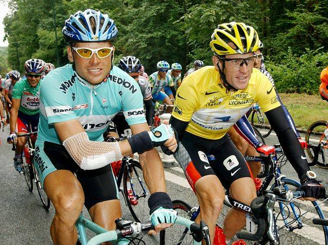 Overall leader Lance Armstrong of Austin, Texas, right, shakes hands with second-placed Jan Ullrich of Germany during the 20th and final stage of the Tour de France cycling race between Ville-d'Avray and Paris, France, July 27, 2003.