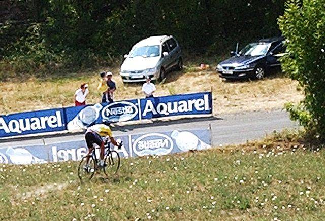 Overall leader Lance Armstrong, of Austin, Texas, rides through a field after he missed a turn, evading Joseba Beloki of Spain, who fell in front of him les than 5 miles before the finish in Gap, Monday, July 14, 2003, during the 9th stage of the Tour de France cycling race between Bourg d'Oisans and Gap, southeastern France. Beloki pulled out of the race, while Armstrong retained the lead of the race.