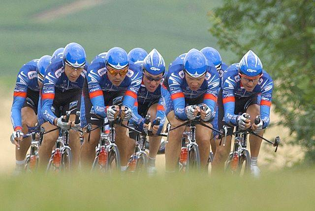 Riders of the U.S. Postal Service team, with Lance Armstrong of Austin, Texas, placed at center with dark glasses, pedal to the finish of the the fourth stage of the Tour de France, a 42 mile team time trial between Epernay and Chateau-Thierry, eastern France, Wednesday July 10, 2002.