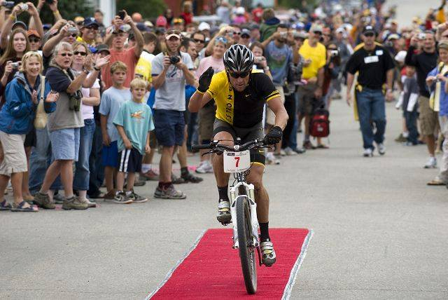 In this photo provided by Alex Fenlon, Lance Armstrong crosses the finish line of the Leadville 100 mountain bike race on Saturday, Aug. 9, 2008, in Leadville, Colo. Armstrong finished second.