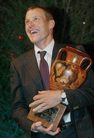 Champion cyclist Lance Armstrong holds a replica of an ancient Greek amphora at a party in New York City which celebrated Armstrong being named the Sports Illustrated's 2002 Sportsman of the Year, in 2002. Armstrong who won his fourth consecutive Tour de France this year, was chosen for symbolizing in character and performance, the ideals of sportsmanship.