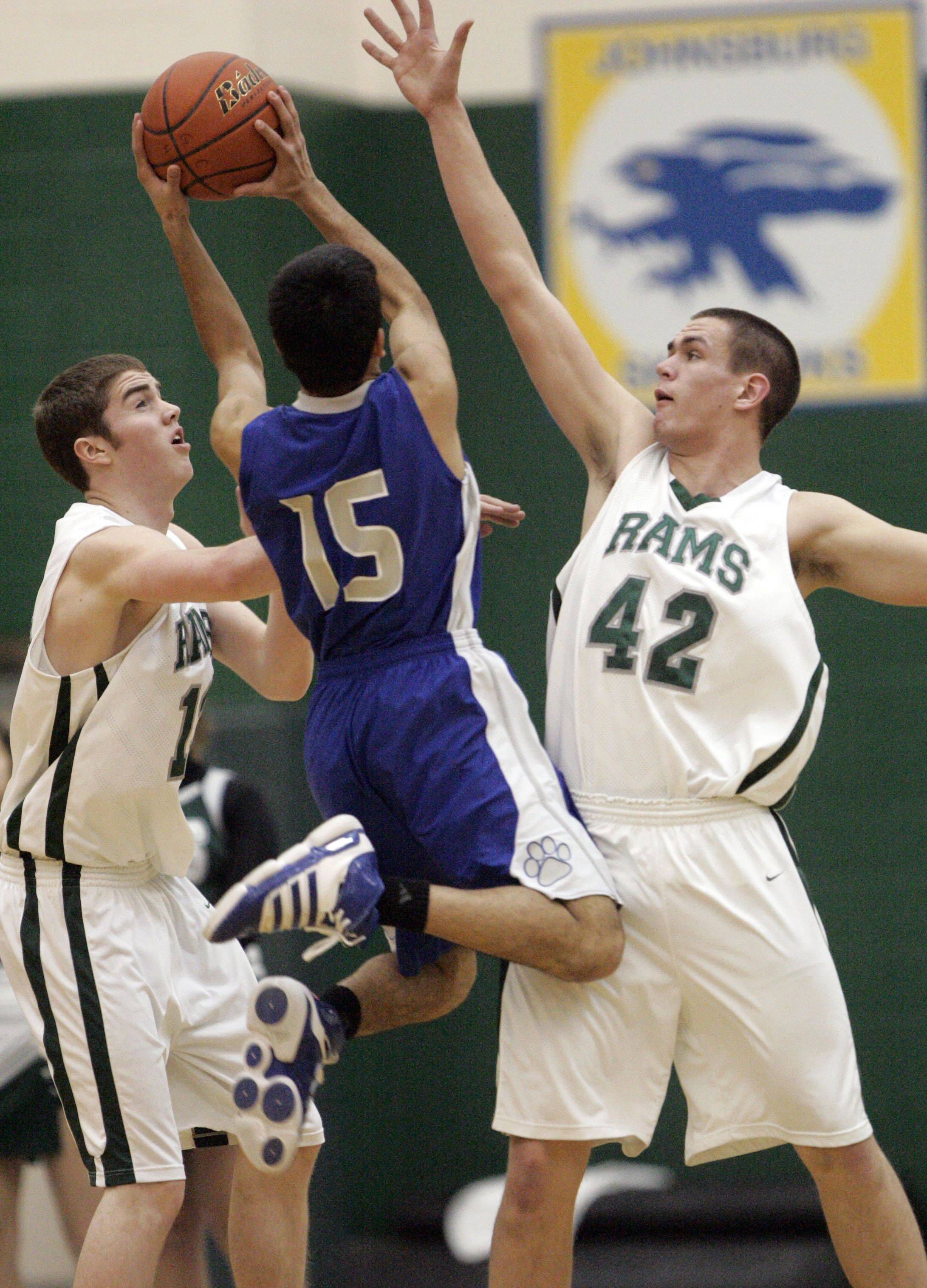 Vernon Hills' Darren Hoveydai drives on Grayslake Central's Tim Abbott, left, and CJ Stempeck .