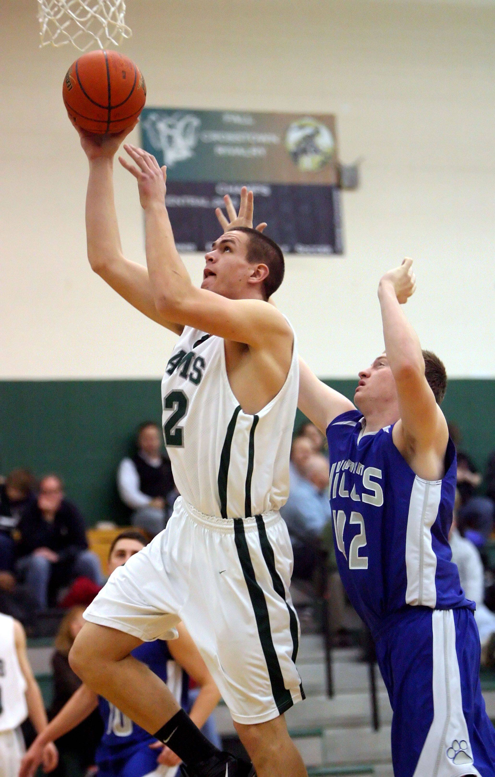 Grayslake Central's CJ Stempeck drives past Vernon Hills' John Foley.