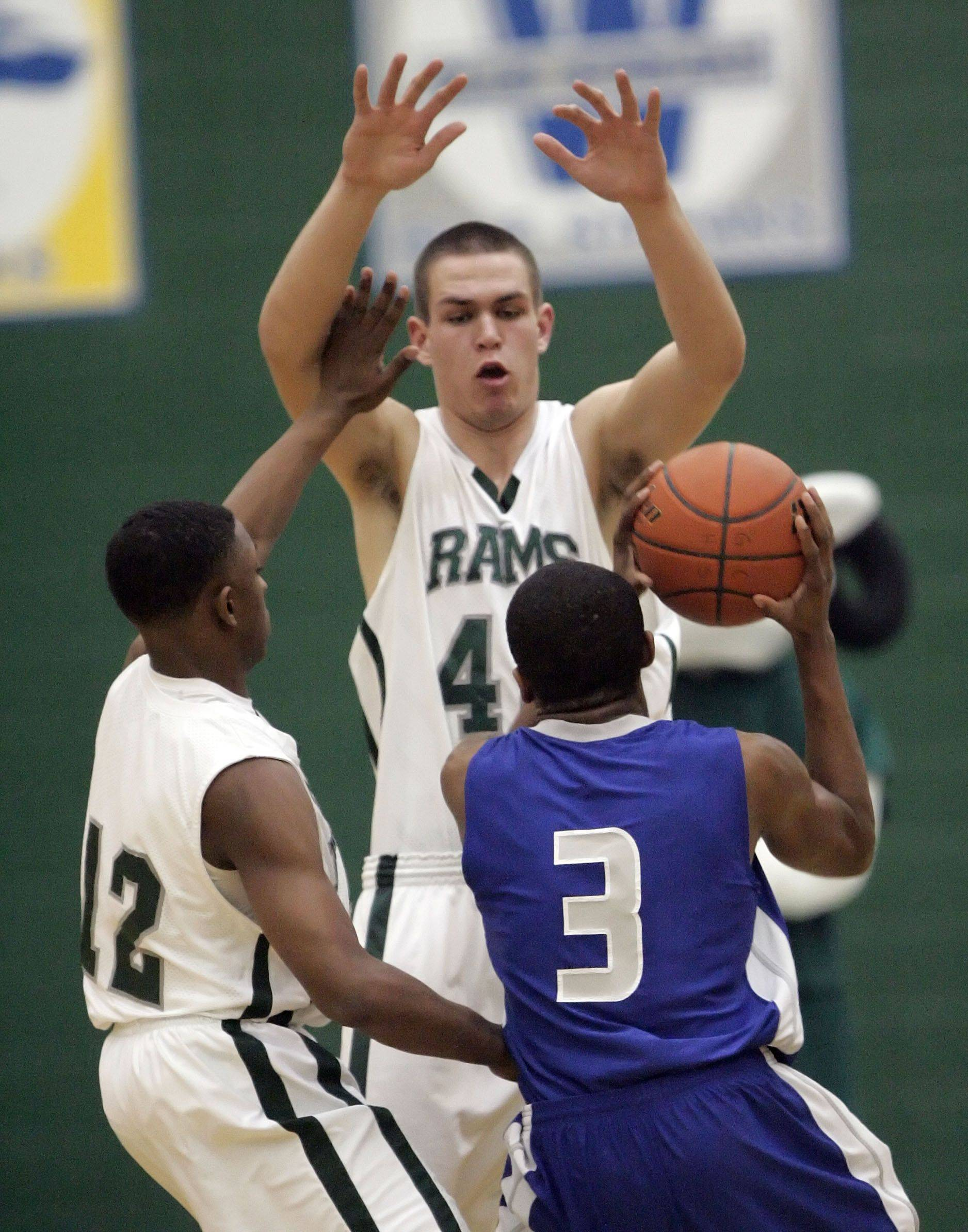 Vernon Hills' Stephen Curry drives on Grayslake Central's Savonte McWiliams, left, and CJ Stempeck.