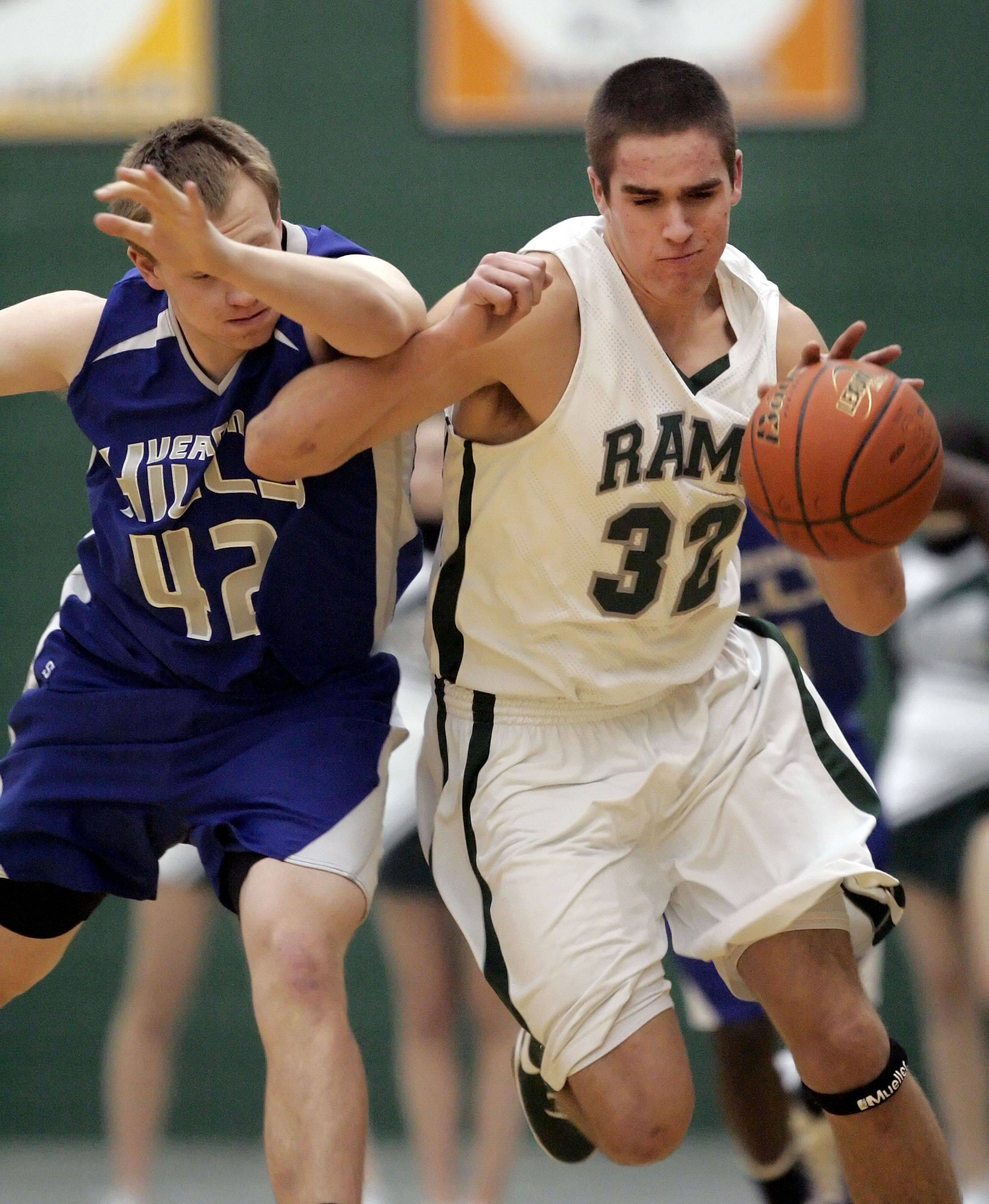 Vernon Hills' John Foley, left, and Grayslake Central's Casey Boyle battle for a loose ball .