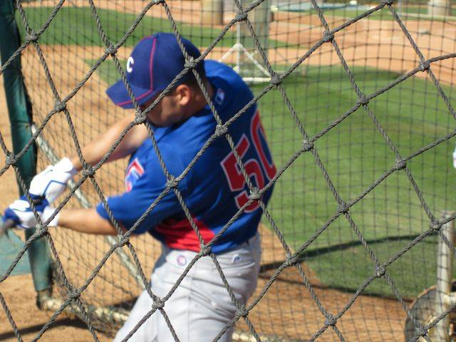 Images from Cubs players and personnel at spring training in Mesa on Wednedsay. Augie Ojeda hits in the batting cage.
