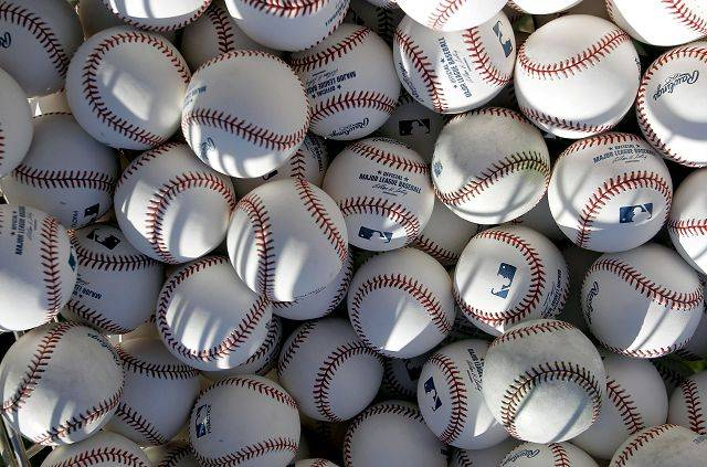 Dozens of baseballs await morning practice by the Chicago Cubs during baseball spring training Wednesday, Feb. 16, 2011, in Mesa, Ariz.