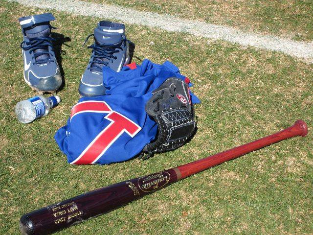 Images from Cubs players and personnel at spring training in Mesa on Wednedsay. New pitcher Matt Garza's bat and equipment is pictured.