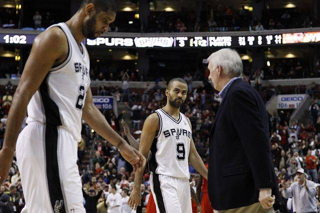 San Antonio Spurs' Tony Parker, center, and Tim Duncan are two of the reasons why the Spurs have the best record in the NBA. The Bulls host the Spurs on Thursday.
