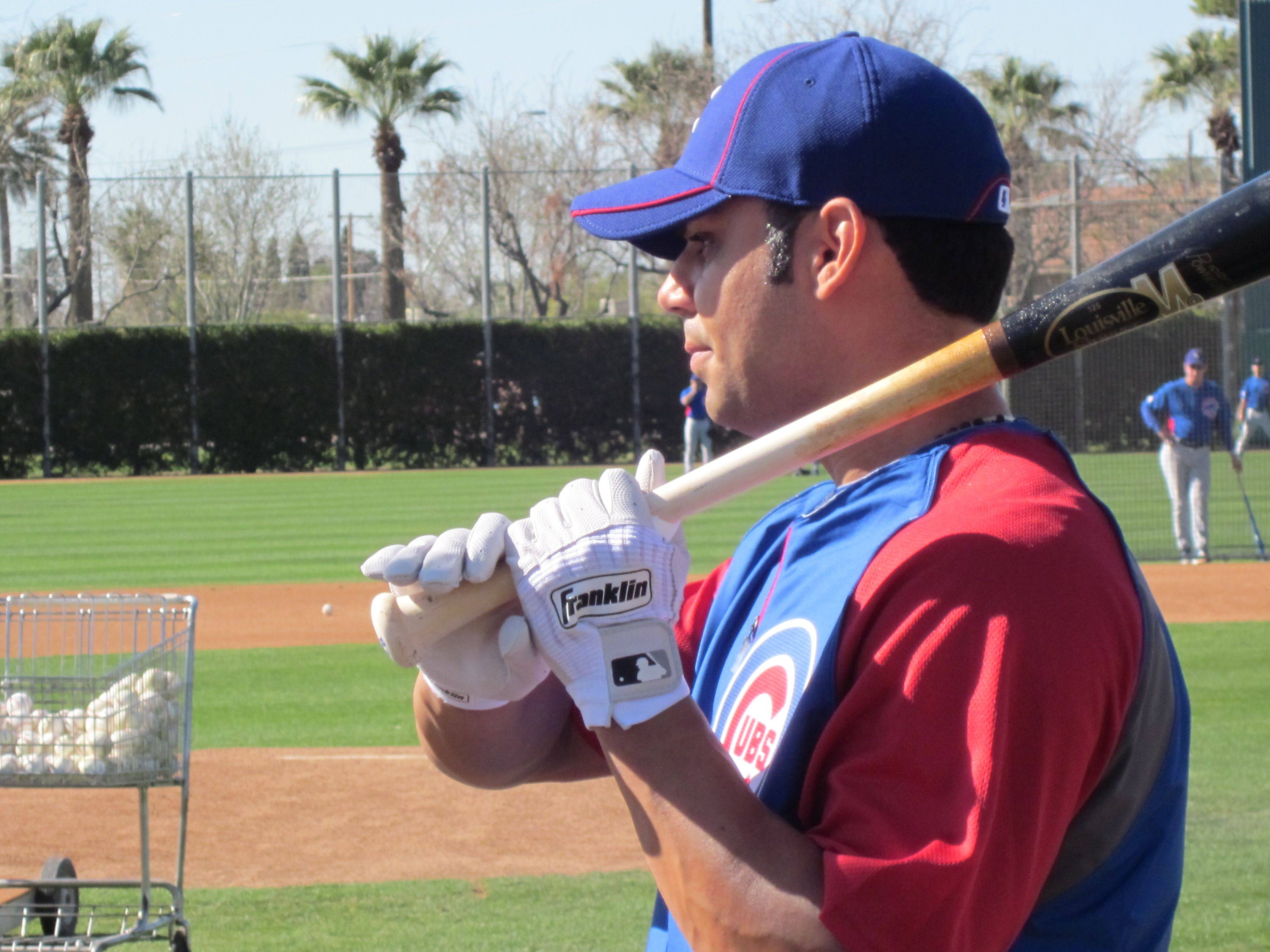 New Cubs first baseman Carlos Pena says last year's hitting slump is in the past and he's working hard to not take any added pressure with him into the batting box this season.