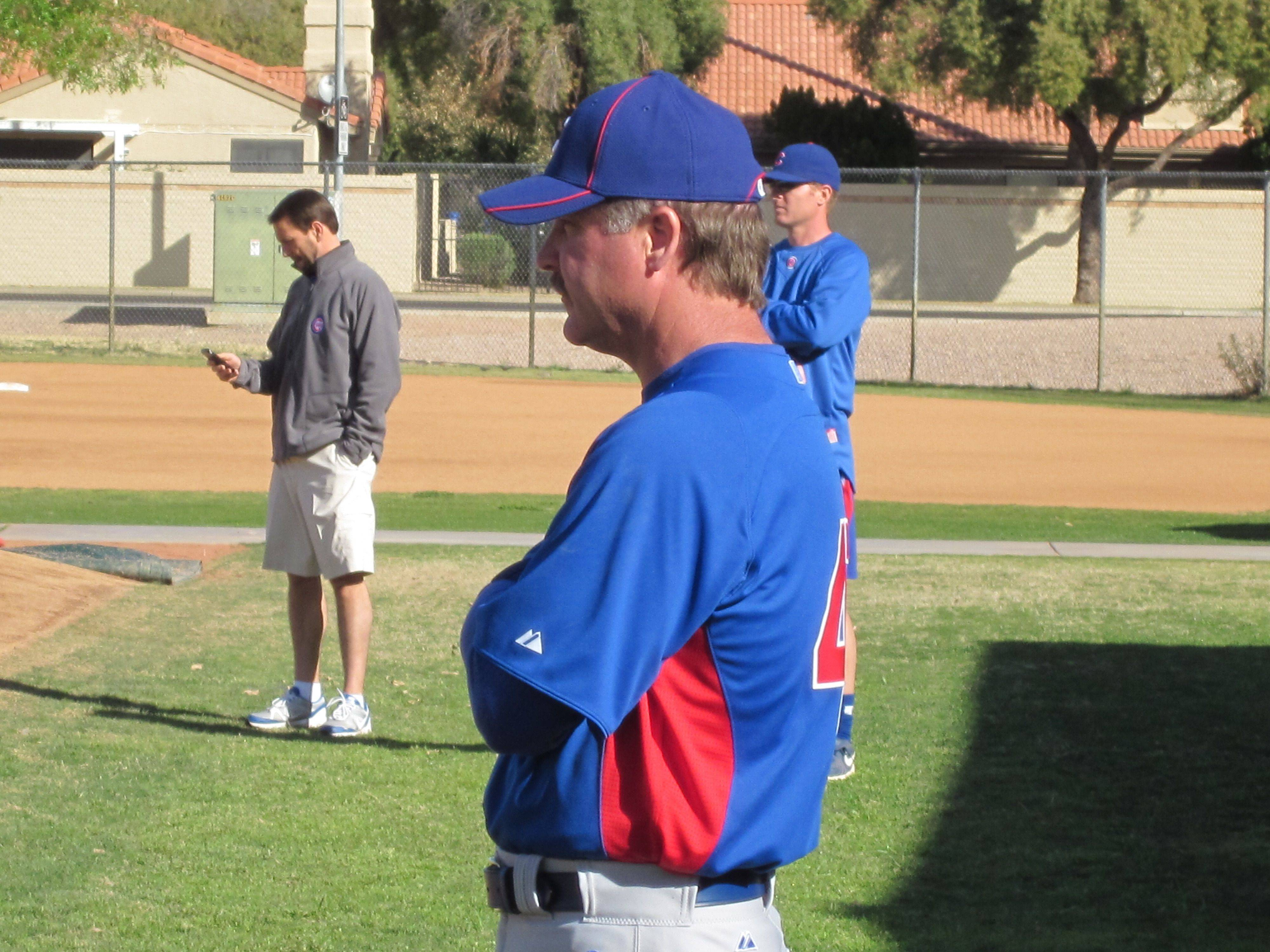 Images from Cubs players and personnel at spring training in Mesa on Thursday.