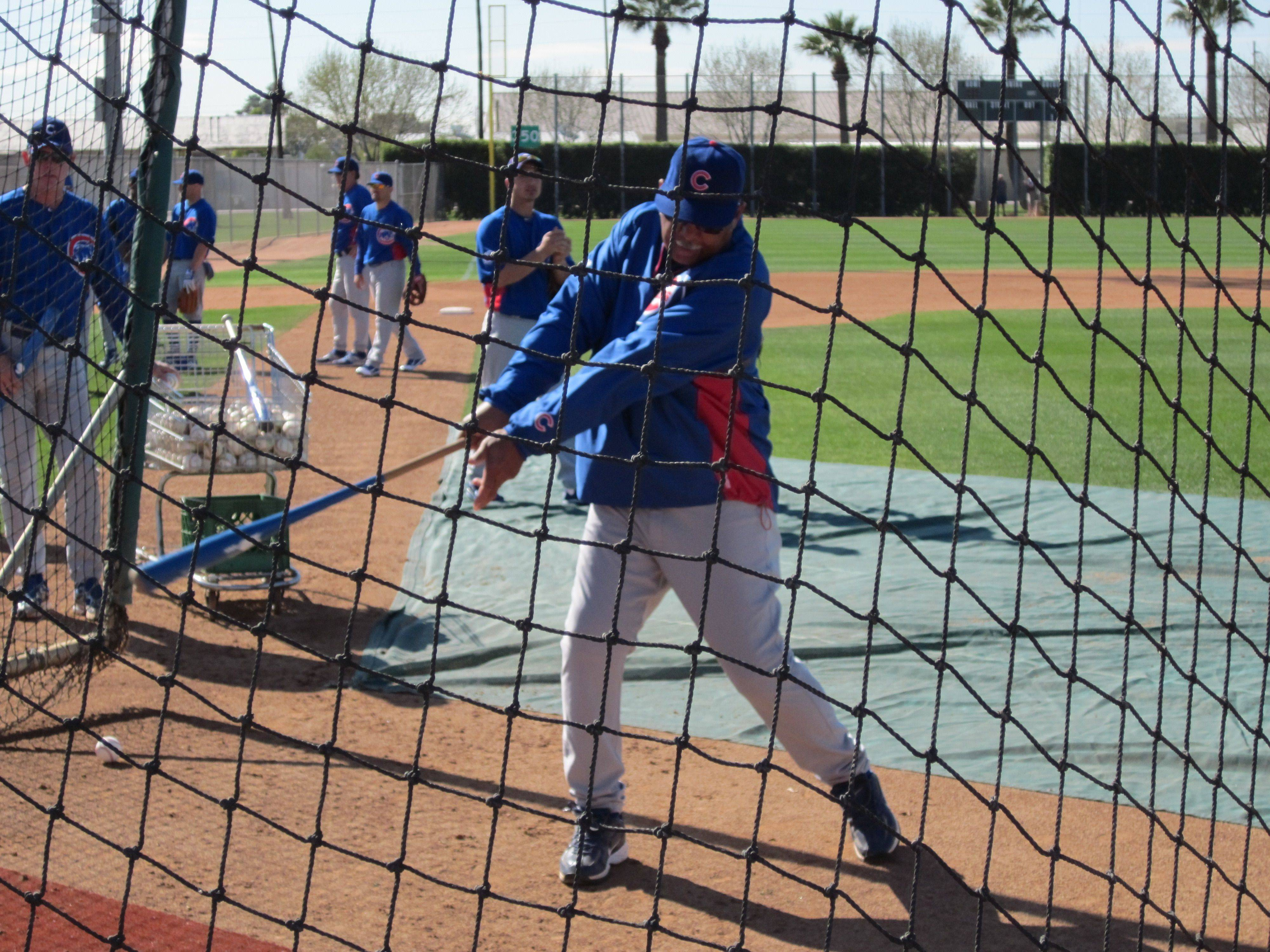 "Images from Cubs players and personnel at spring training in Mesa on Thursday. Billy Williams showing he still has�a ""sweet swing"" in the cage"