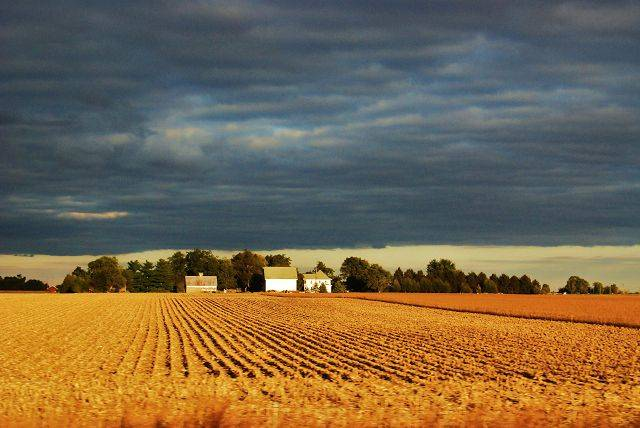 An impending storm approaches a farm house south of Springfield last September.