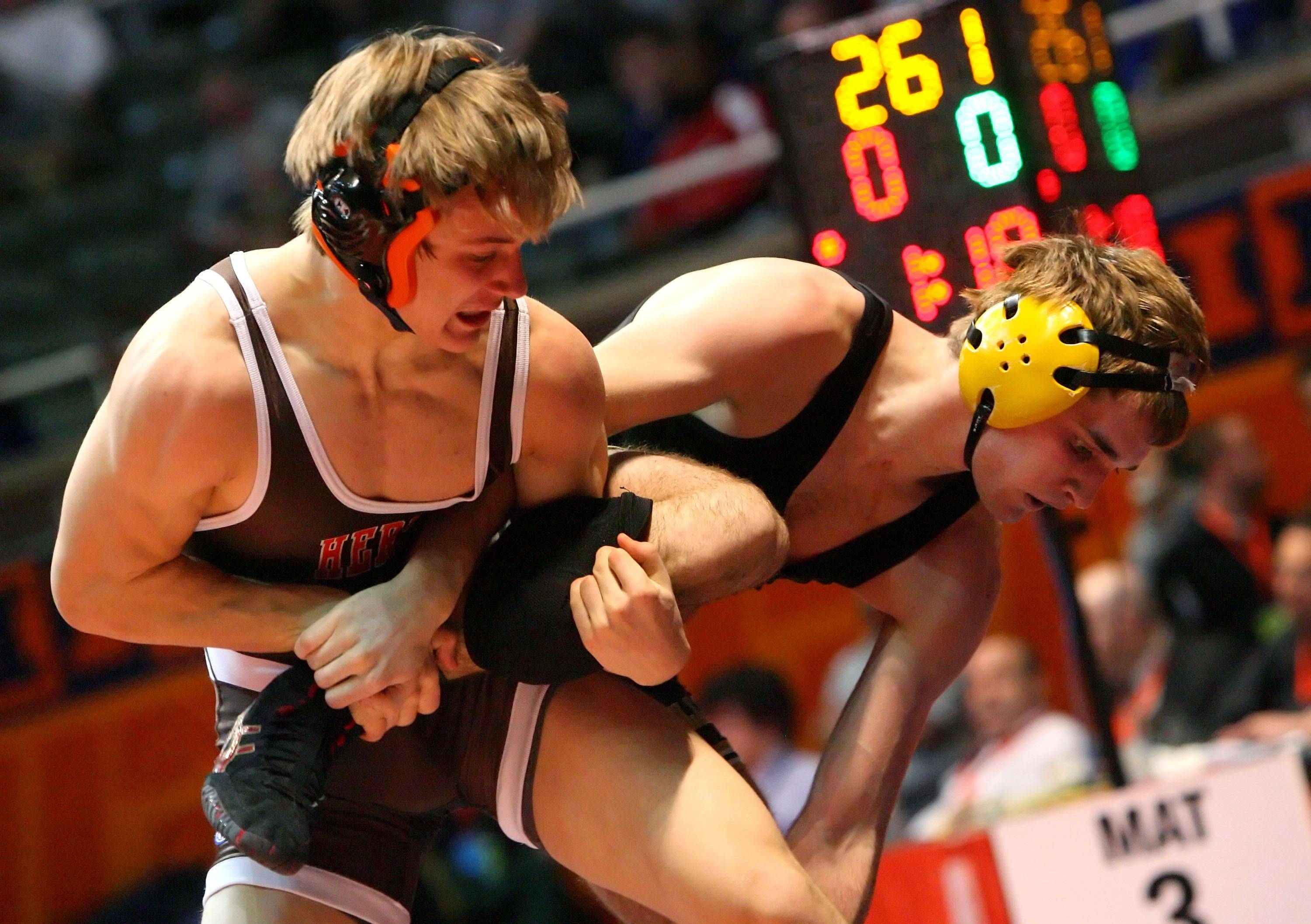 Hersey's Hunter Rollins wrestles Batavia's Augie Watson at 152 pounds in the 3a wrestlebacks during state wrestling Friday in Champaign.