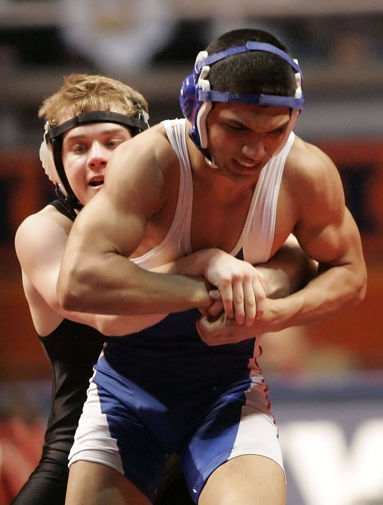 Lakes' Jose Collado wrestles Crystal Lake Centrtal's Clayton Lutzow at 130 pounds in the 2a quarterfinals during state wrestling Friday in Champaign.