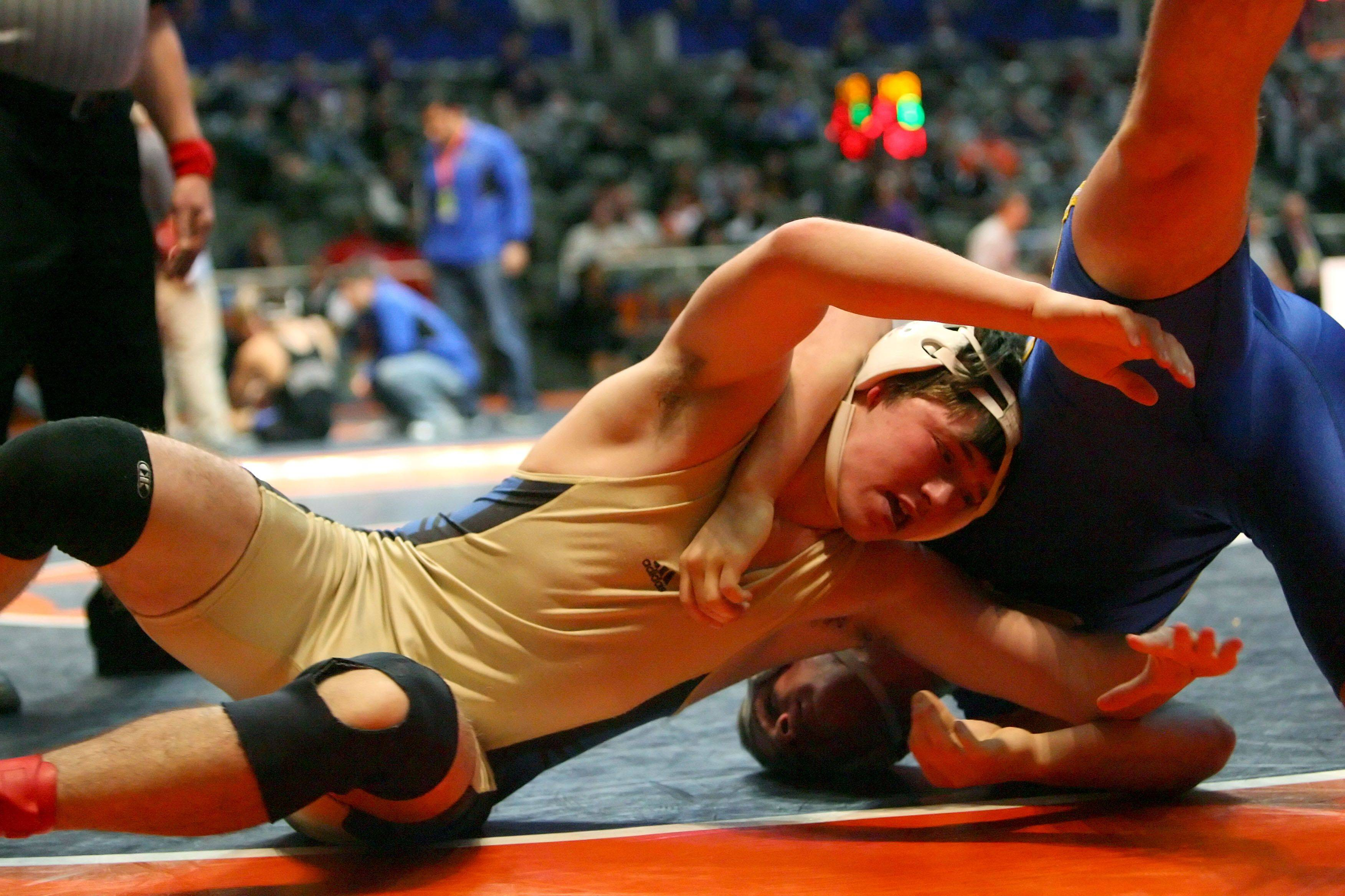 Wheeling's Eddie Scanlon wrestles Orland Park's Brandon Lopez at 171 pounds in the 3a wrestlebacks during state wrestling Friday in Champaign.