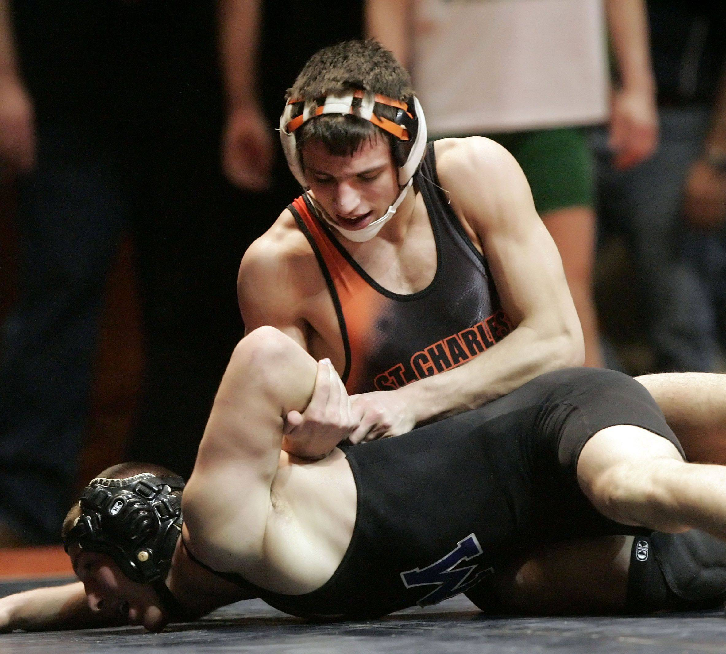 St. Charles East's Nick Ruffino wrestles Mather's Nikko Liotta at 130 pounds in the 3a wrestlesbacks during state wrestling Friday in Champaign.