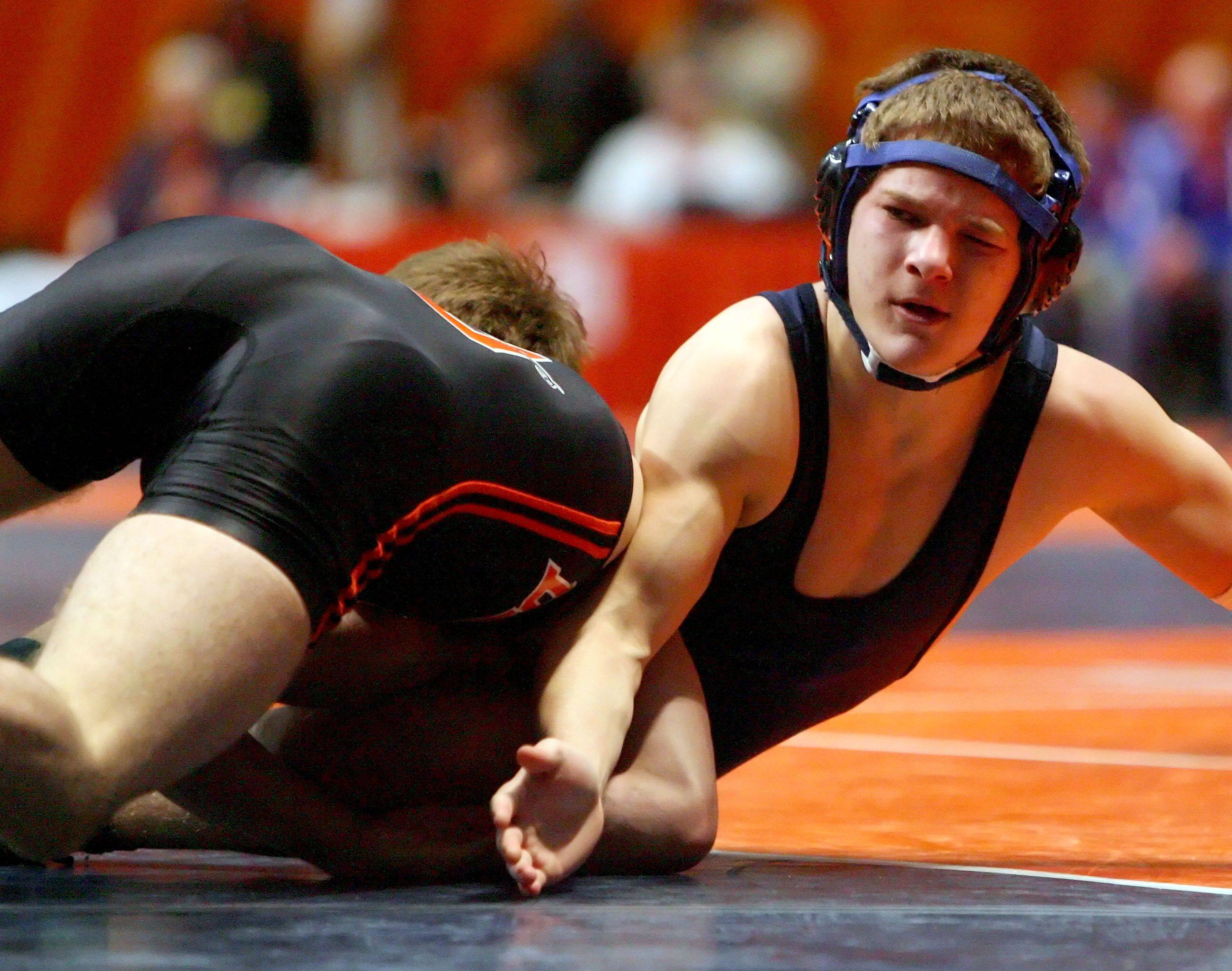 Cary Grove's Trent Atkins Wrestles Dekalb's Doug Johnson at 125 pounds in the 3a wrestlebacks during state wrestling Friday in Champaign.