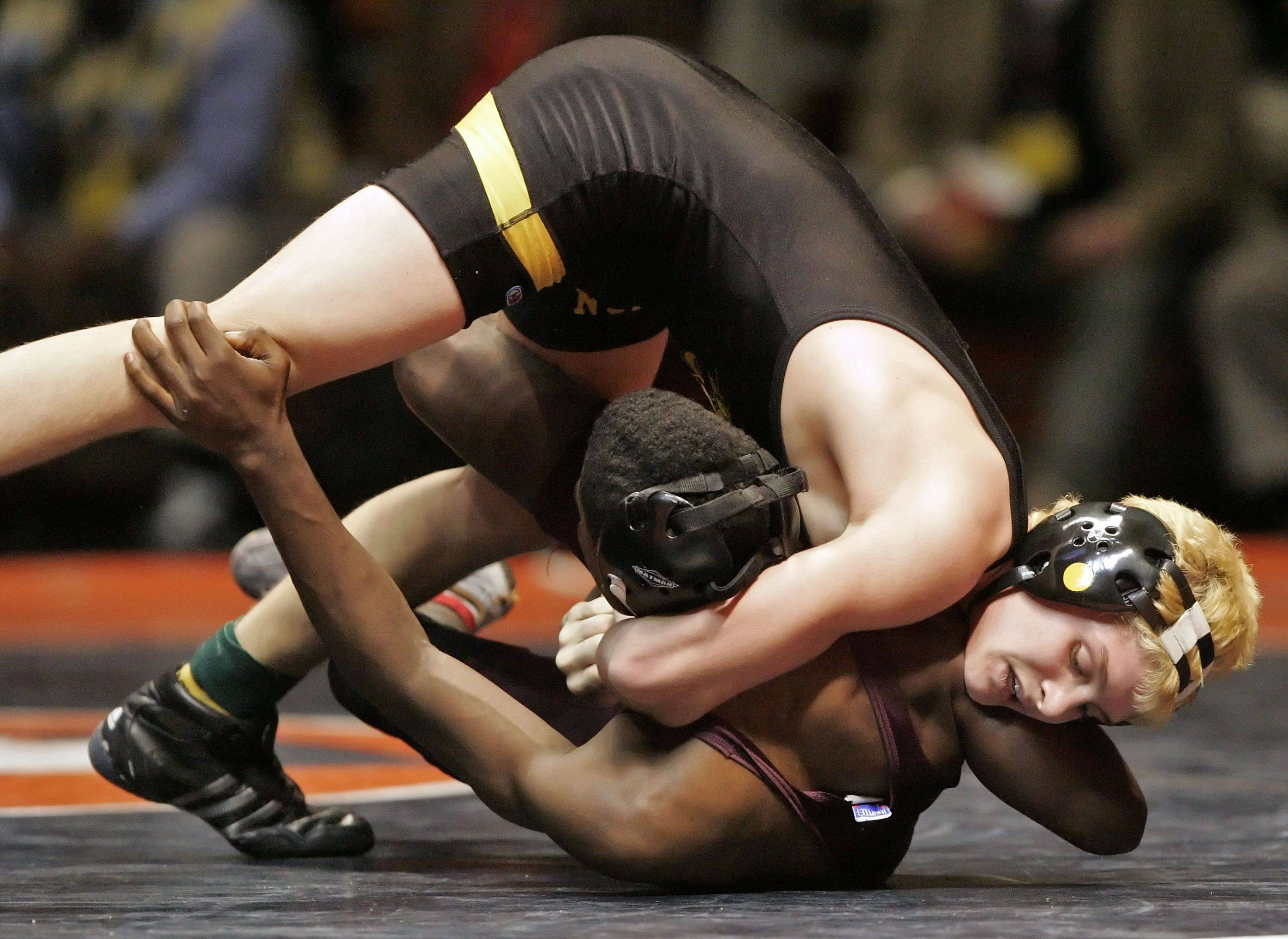 Glenbard North's Johnny Gosinski wrestles Nate Smith of Austin Polytechnic at 112 pounds during state wrestling Friday in Champaign.