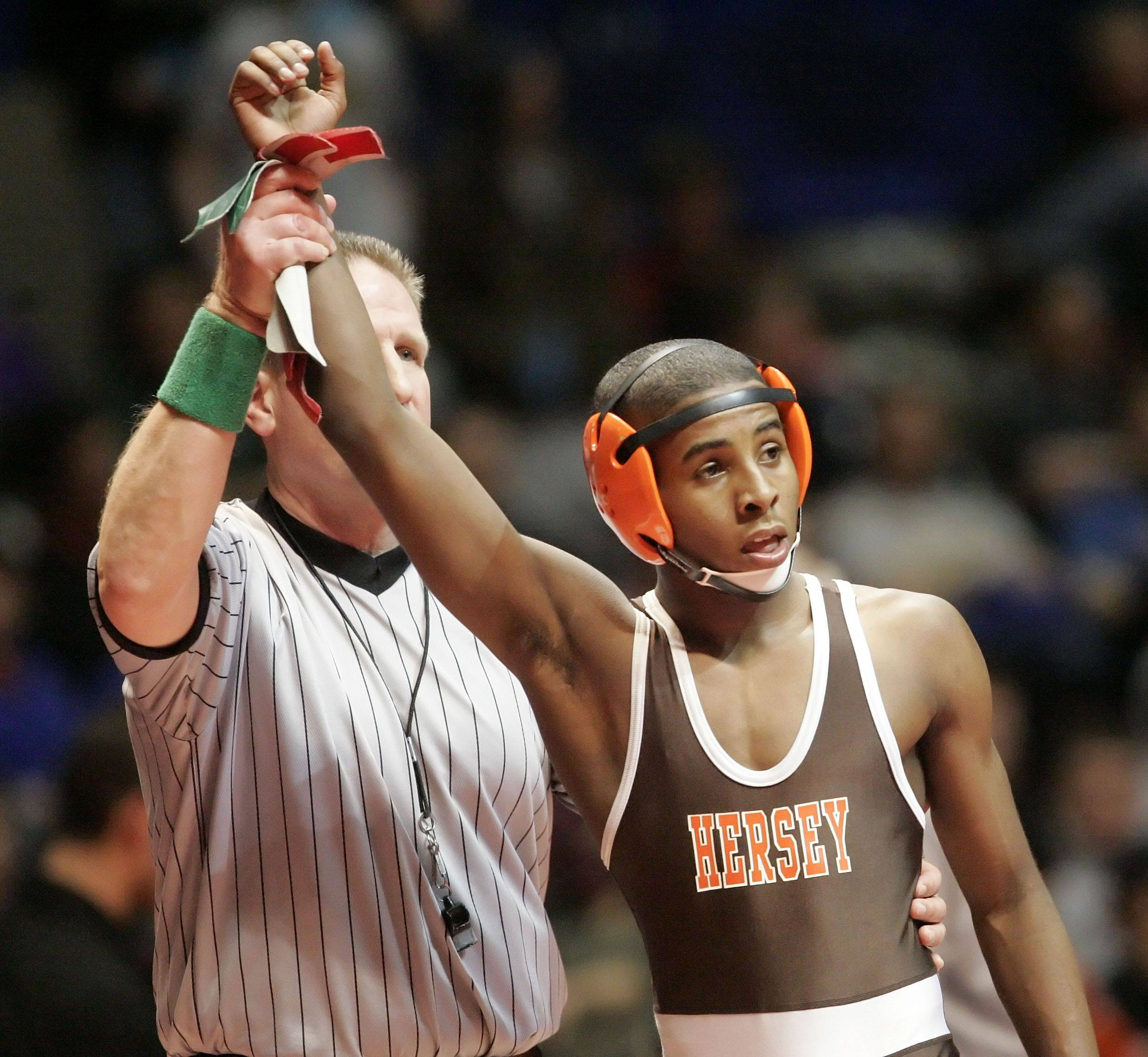 Hersey's Stephfon Scales won his match against Bolingbrook's Frankie Campos at 119 pounds in the 3a wrestlebacks during state wrestling Friday in Champaign.