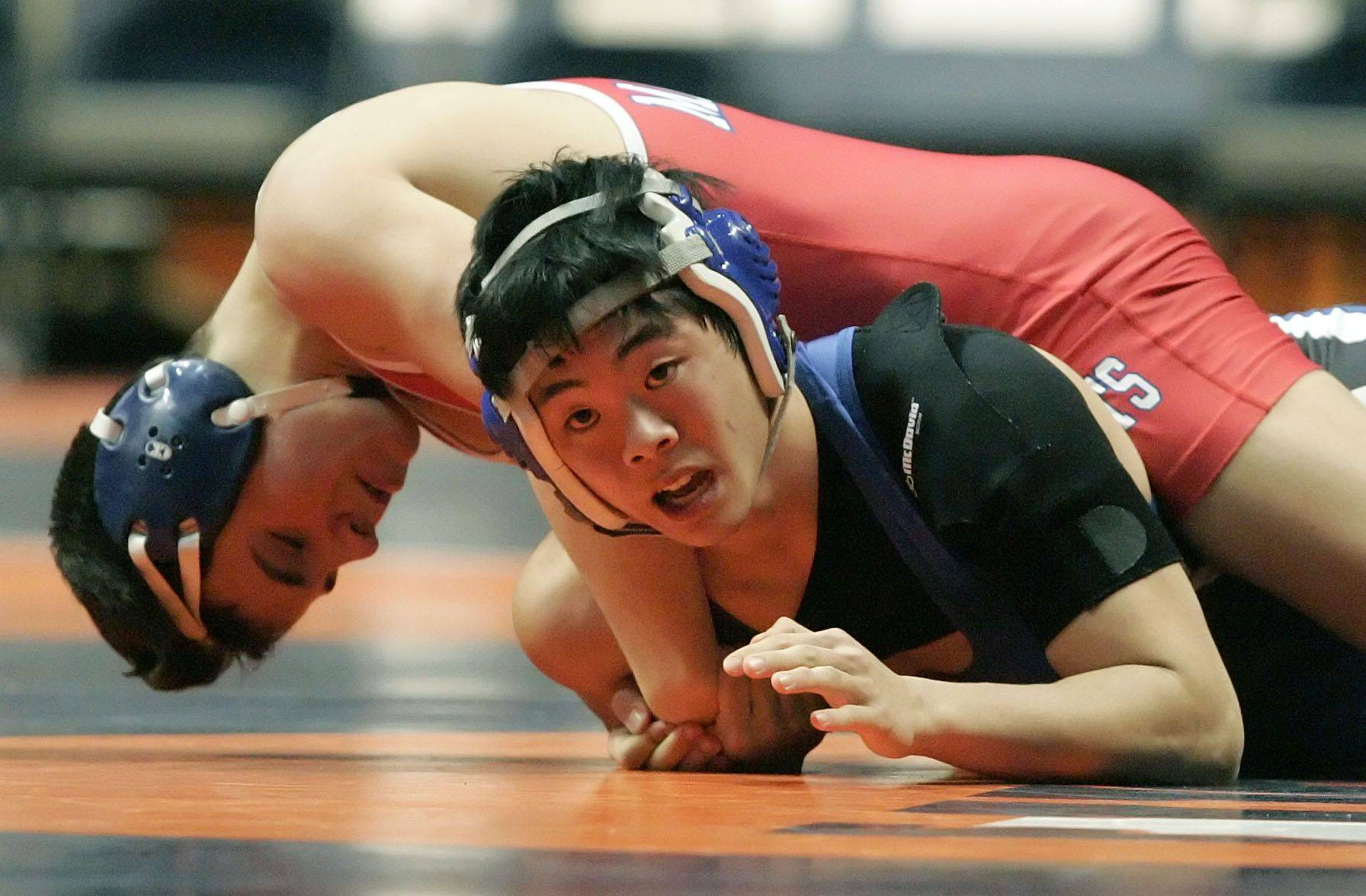 Vernon Hills' Gideon Yim wrestles Marmion's Eddie Greco at 125 pounds in the 2a quarterfinals during state wrestling Friday in Champaign.
